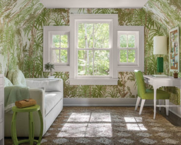 Small Tropical home office with palm trees motif interior wallpaper, windows carpet flooring and a sofa.