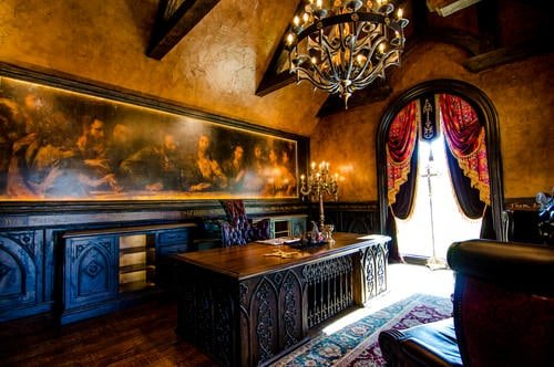Victorian home office with elegant-looking chandelier and wall art design.