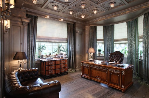 Victorian home office with classy beams with lights ceiling and hardwood flooring.