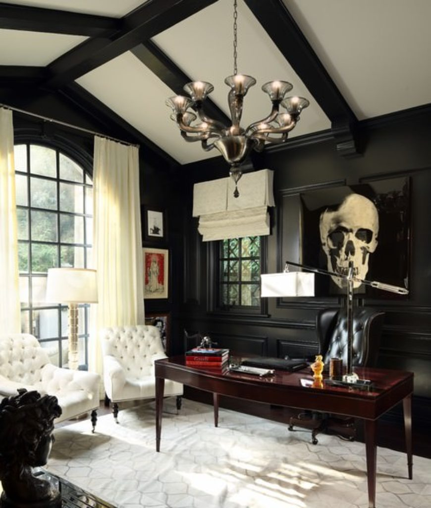 Victorian home office together with cathedral with beams ceiling and dark hardwood walls with skull wall design.