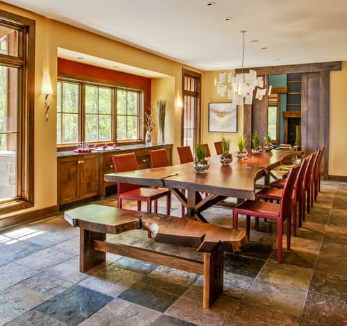 Large Rustic Yellow Dining Room With Chandelier, Wall Sconces, Slate Tile  Flooring And A