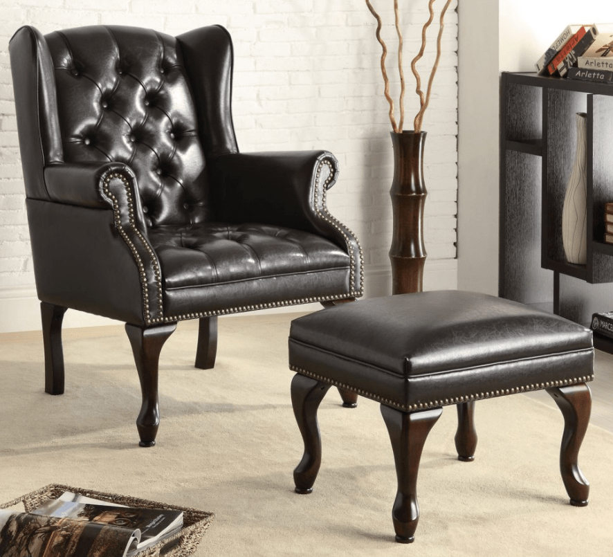 Elegant black tufted leather accent chair with ottoman.