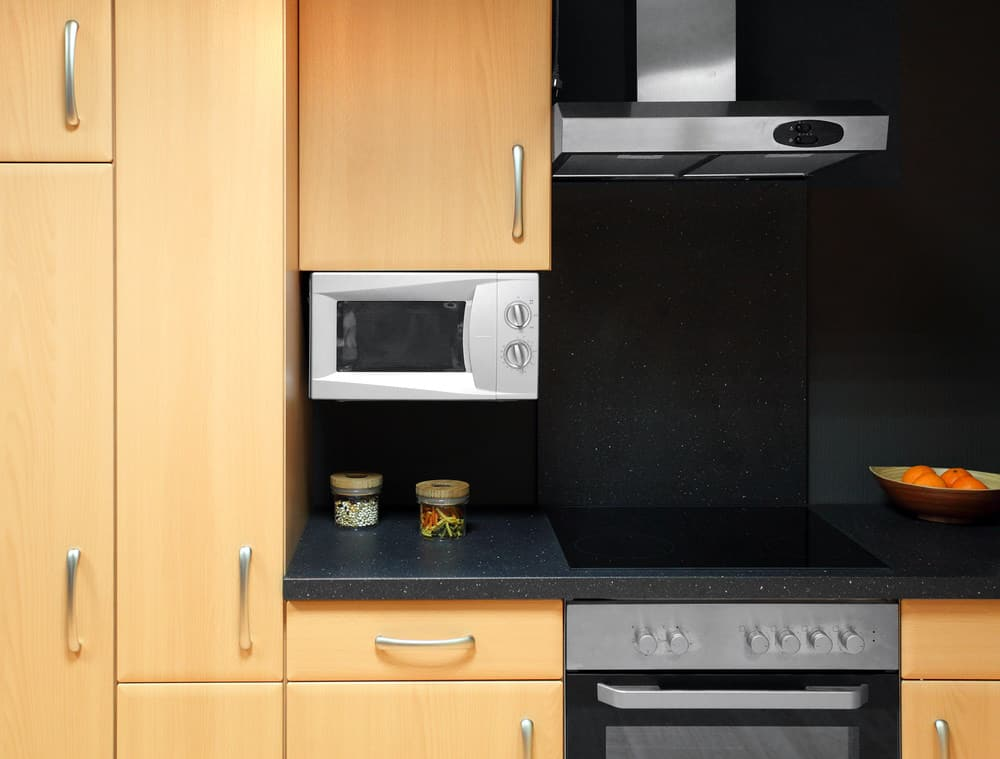 Kitchen with microwave mounted under the upper cabinet