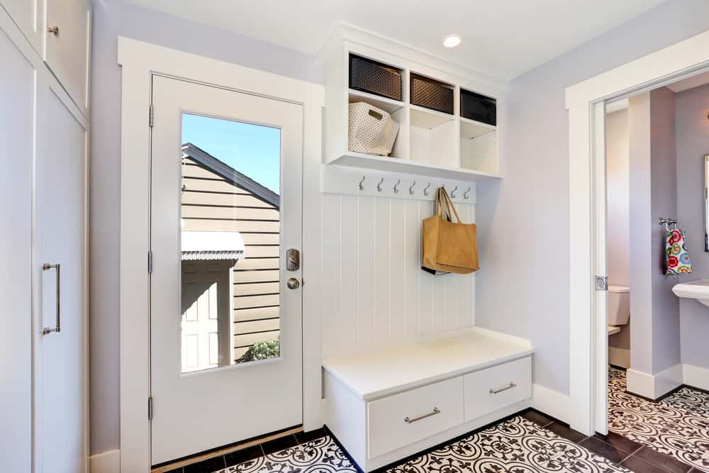 tiled mudroom in a sleek and modern design white as the dominant color in this one makes it look fresh and tidy - Mudroom Design Ideas