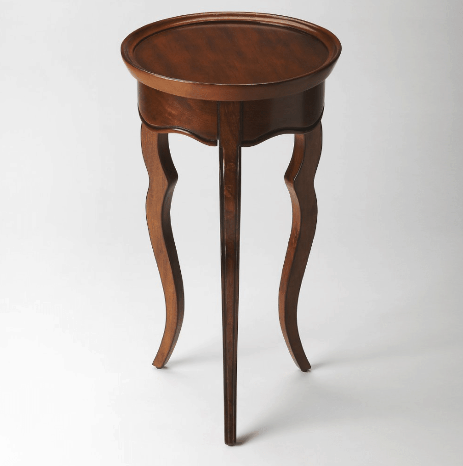 Elegant round wooden accent table.