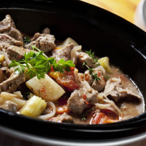Small slow cooker cooking food.