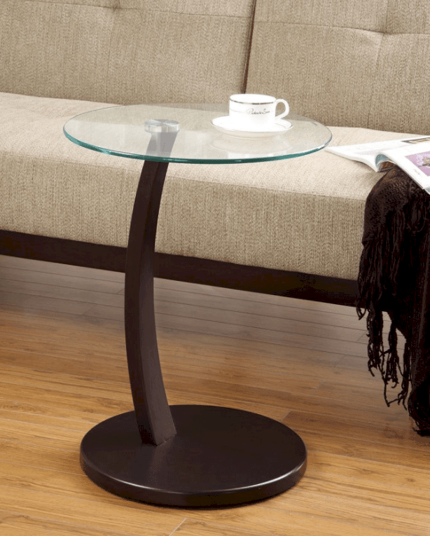 Mini glass-topped accent table.