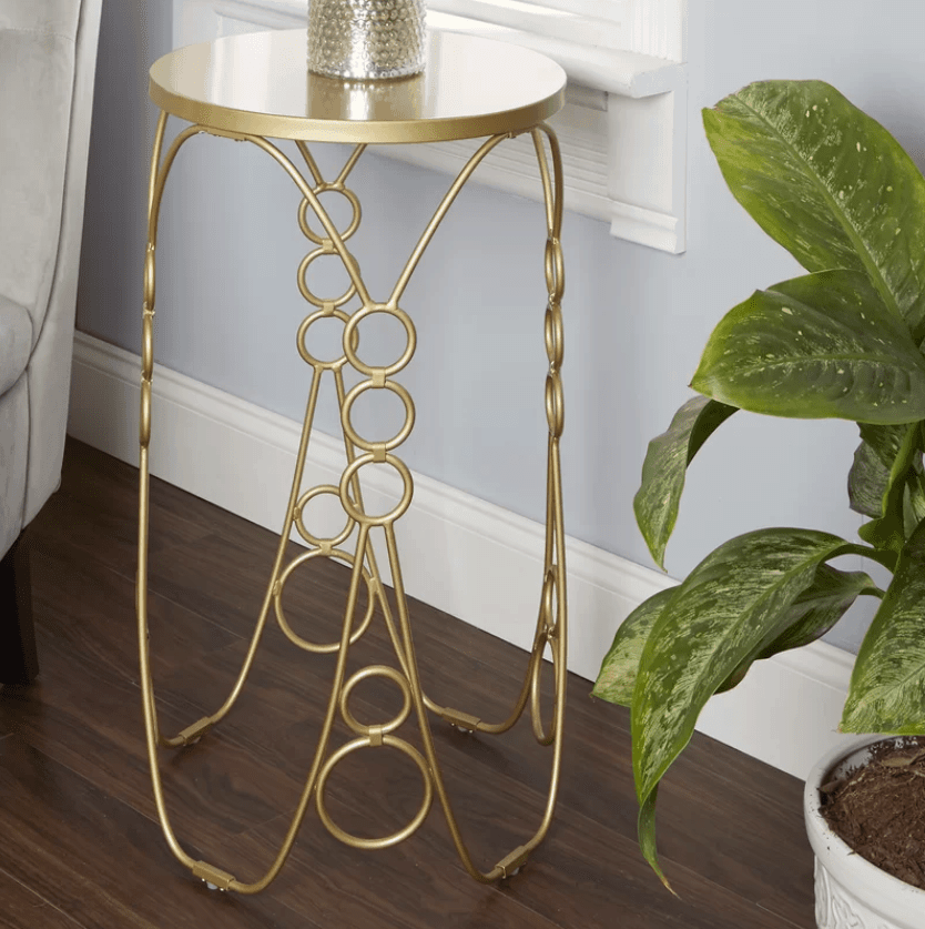 Small gold round accent table.