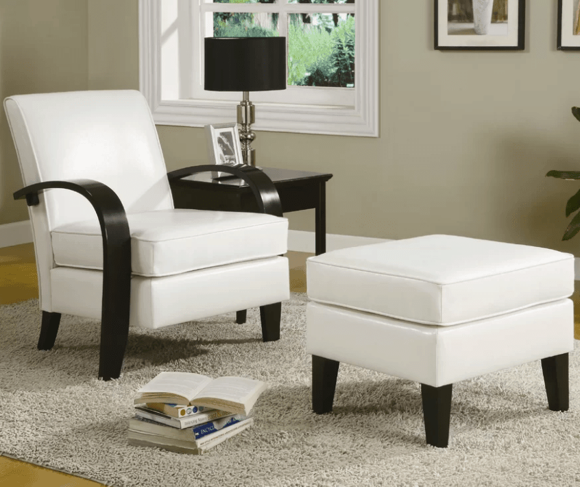 Stylish white accent chair with ottoman