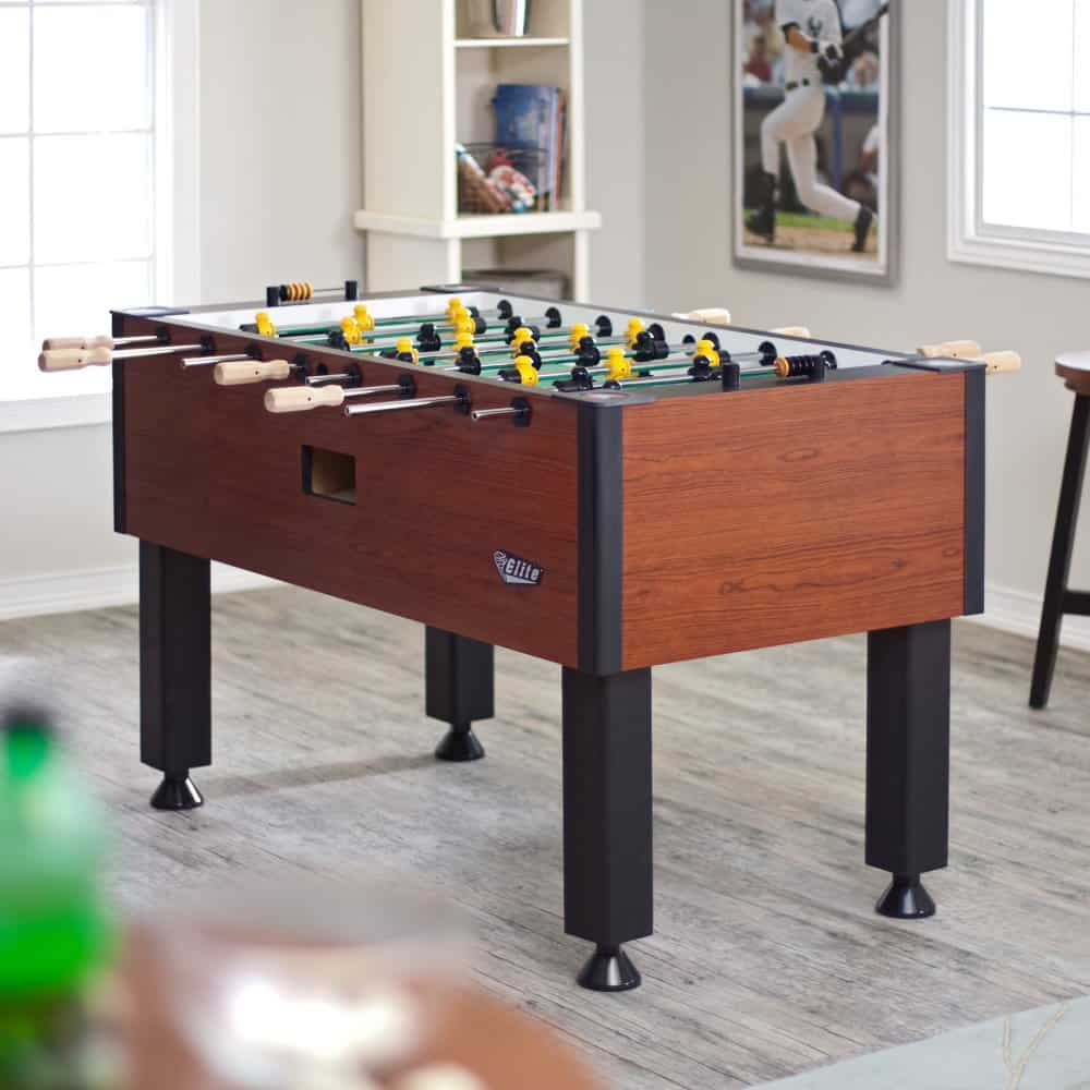 Wooden foosball table perfect for play rooms.