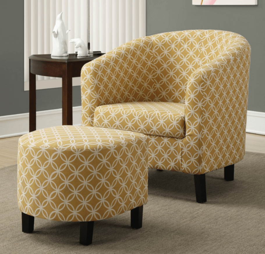 Soft yellow barrel accent chair and round footstool