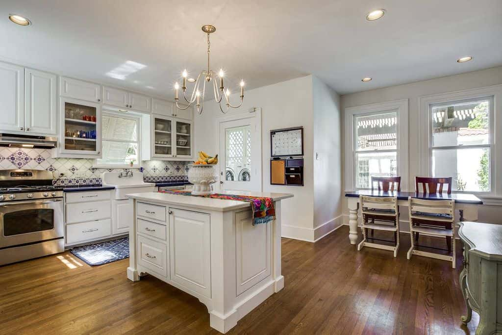 Cottage Country Kitchen With White Cabinetry And Island 1 Light Mini Pendant Bar StoolsSource Wayfair