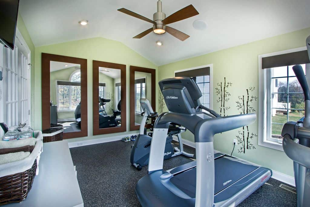 Contemporary home gym with recessed lighting and tiled floor.
