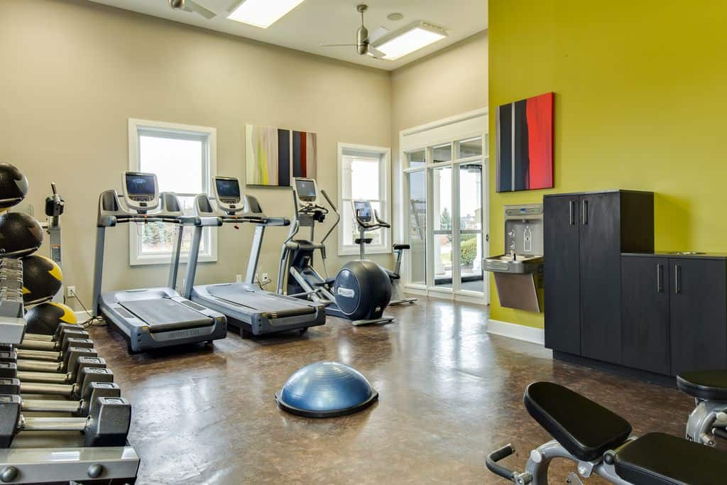Contemporary Home Gym With Ceiling Fan And High Ceiling.Source: Zillow Digs