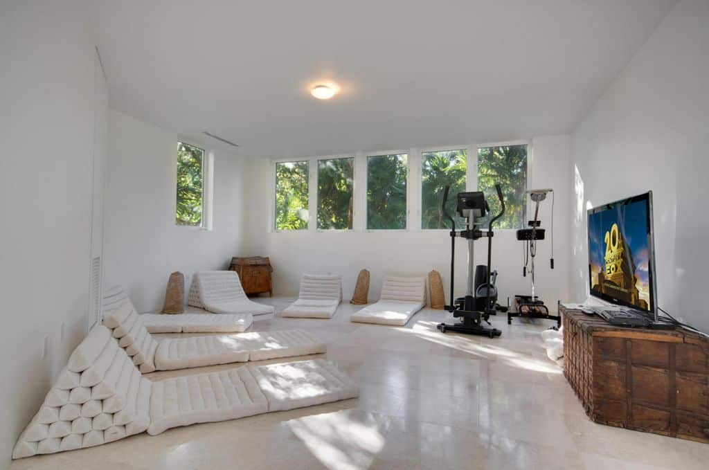 Contemporary Home Gym With White Walls And Tiled Floor.Source: Zillow Digs