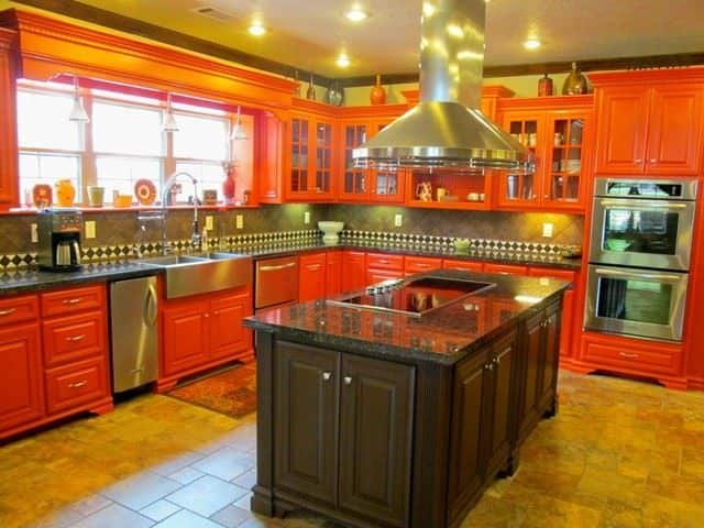 Country Orange Kitchen With Tiled Floor And Center Island