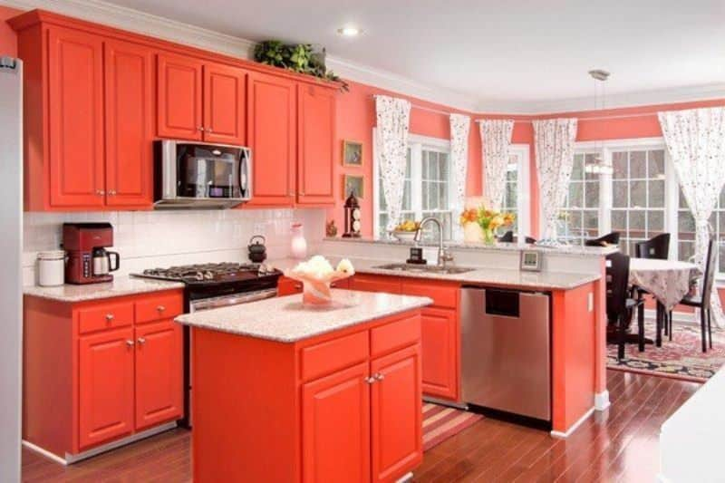Eclectic Orange Kitchen With Cabinets And Hardwood Floor