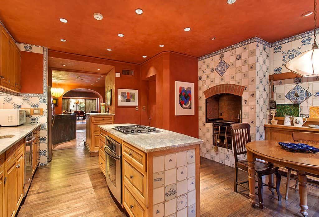 Mediterranean Orange Kitchen With Hardwood Floor And Recessed Lights.