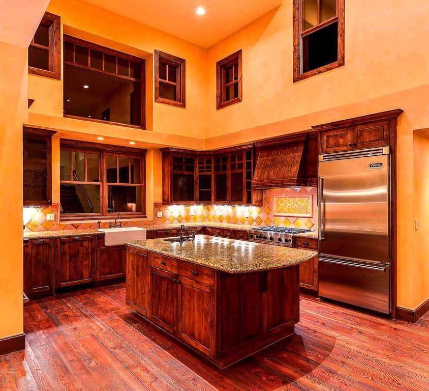 Traditional Orange Kitchen With Hardwood Floor And Center Island