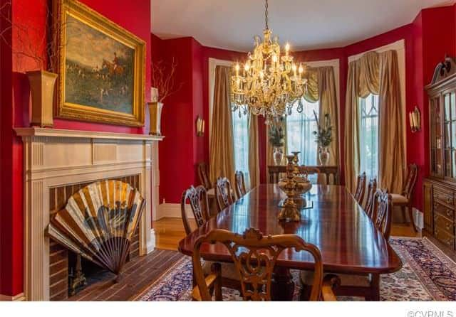 Traditional Red Dining Room With Chandelier And Rectangular Table