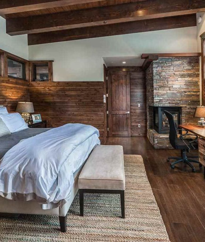 This room is so calming, with its sharp textures of dark brown and rustic wood and stones. This is such a perfect vibe for a master bedroom.