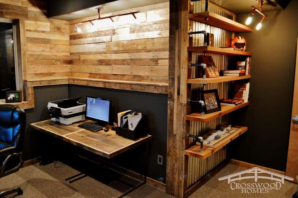 Here's a classic rustic style home office with lots of distressed wood and matching distressed wood desk.