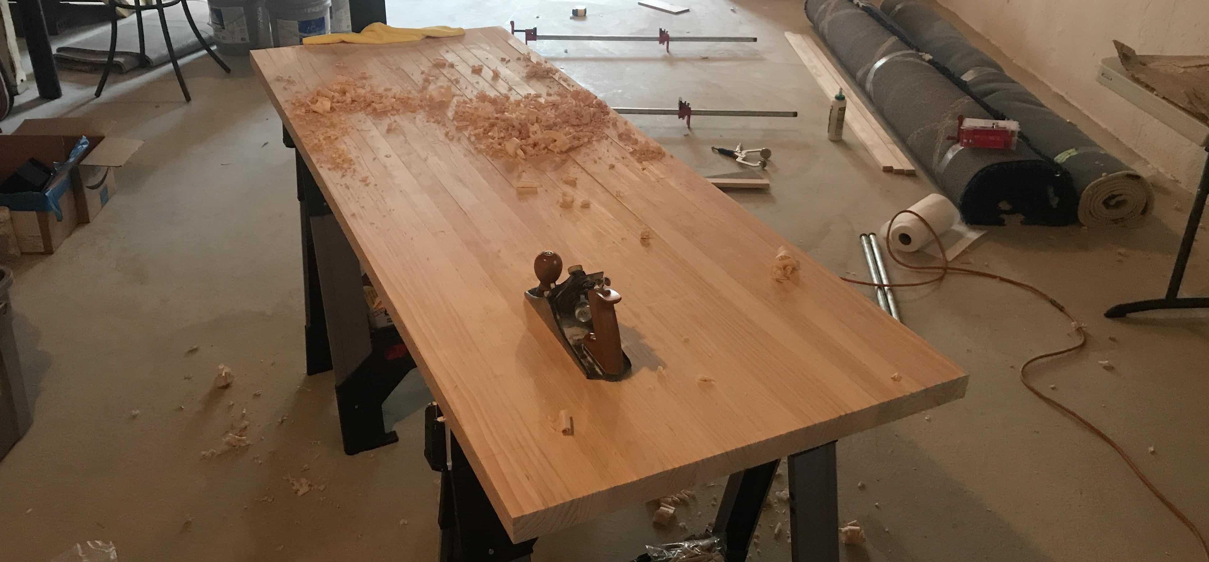 Planing wood desktop for standing desk.
