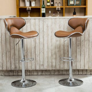 Adjustable swivel bar stool with chrome base and faux leather seat.