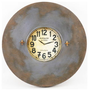 Antique wall clock printed with french along with gold fleur-de-lis magnets on both sides.