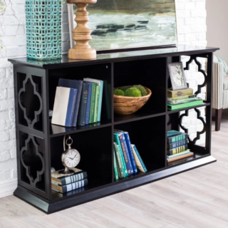 6-cube bookcase with solid birch frame and open quatrefoil side design.