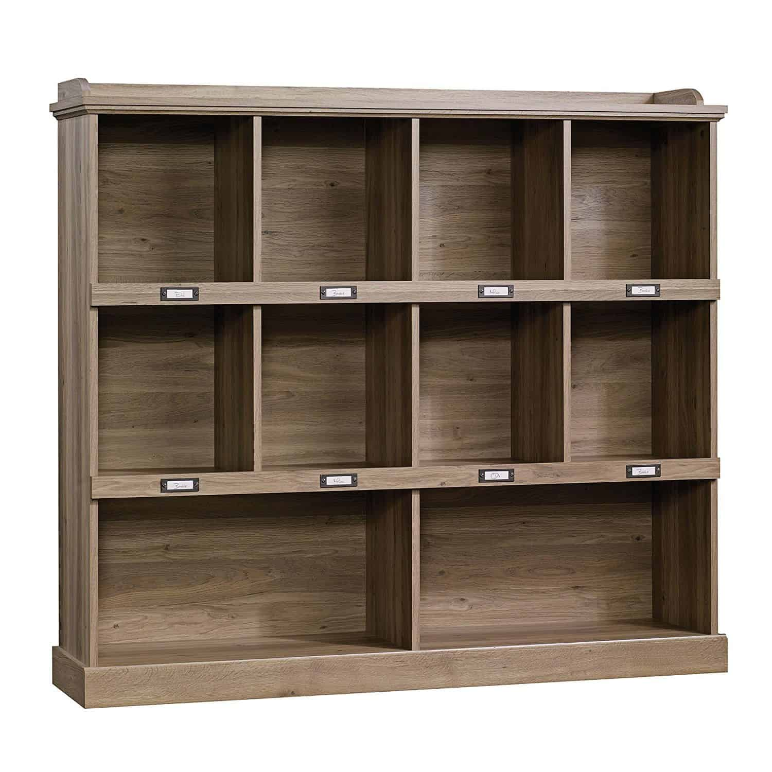 Laminated oak finish bookcase with cubbyhole storage and top shelf for gallery display.