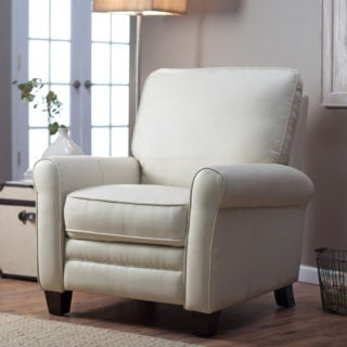 Contemporary recliner with push-back feature and bonded leather upholstery in stagecoach-cream color.