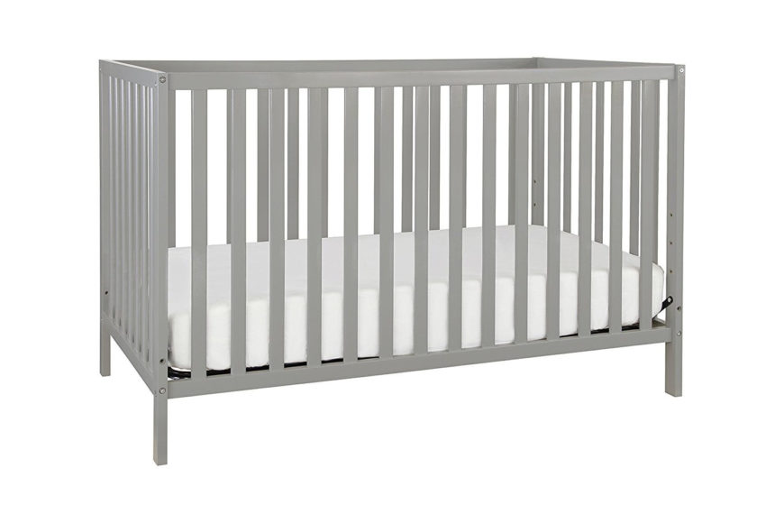 Convertible crib with non-toxic gray finish and four adjustable mattress levels.