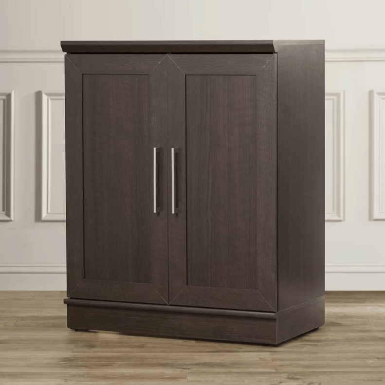 2 door storage cabinet with dakota oak finish and bar pull cabinet handle design.