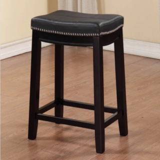 Dark espresso counter stool with nail head accents and polyurethane seat.