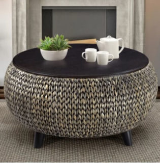 Upholstered coffee table with the top part made up of wood for a sturdy finish.