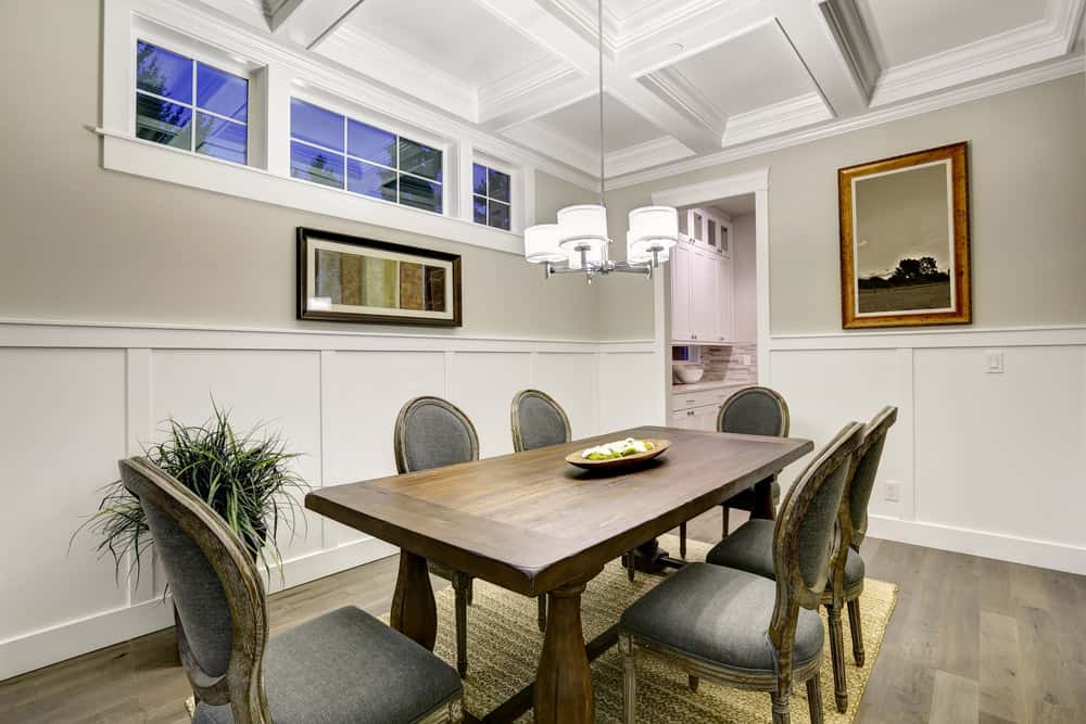 Beach Dining Room With Unique Chandelier And Glass Windows Door Photo By Scenic Sothebys International Realty