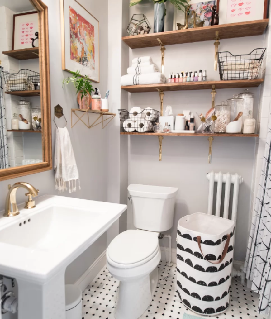 Eclectic small bathroom with white walls and built-in shelves together with pedestal sink and stylish tiles flooring.