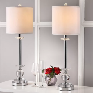 Elegant looking table lamp with chrome base and crystal fixture material.
