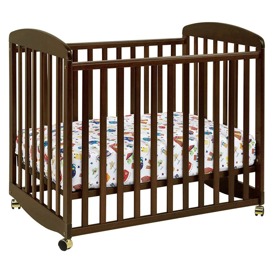 Mini rocking crib with espresso finish and adjustable mattress positions.