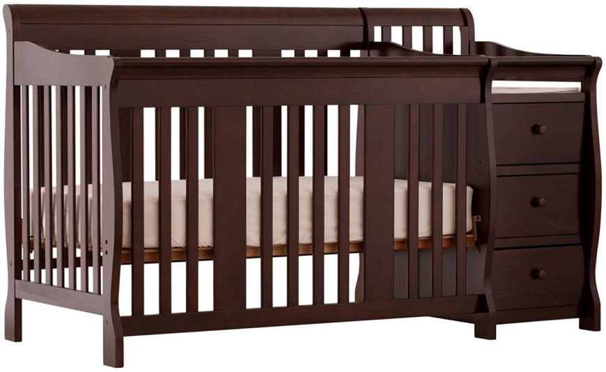 Side convertible crib and changer combination with espresso finish and cabinets.