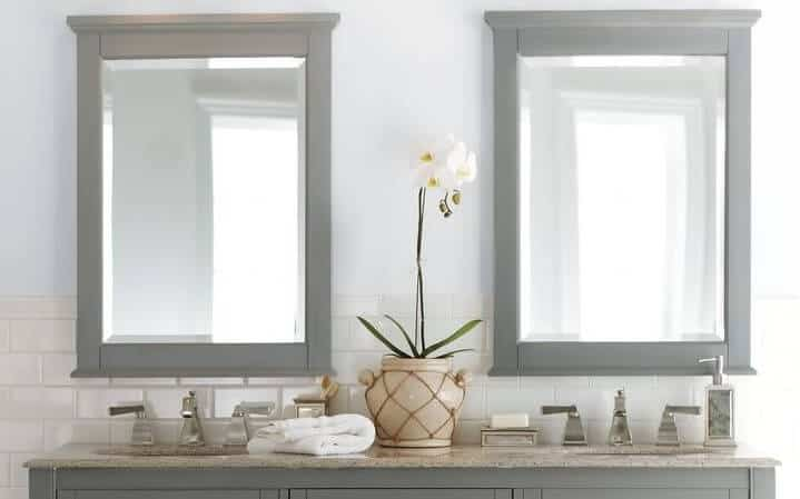 Bathroom with two small mirrors side-by-side with light gray frame.