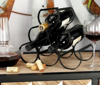 Iron black wine rack with triangular shape.
