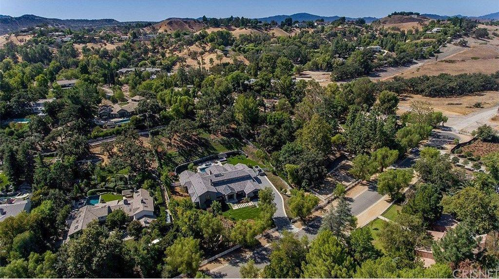 Another aerial view of Kris Jenner's mansion featuring the beautiful and peaceful surroundings.