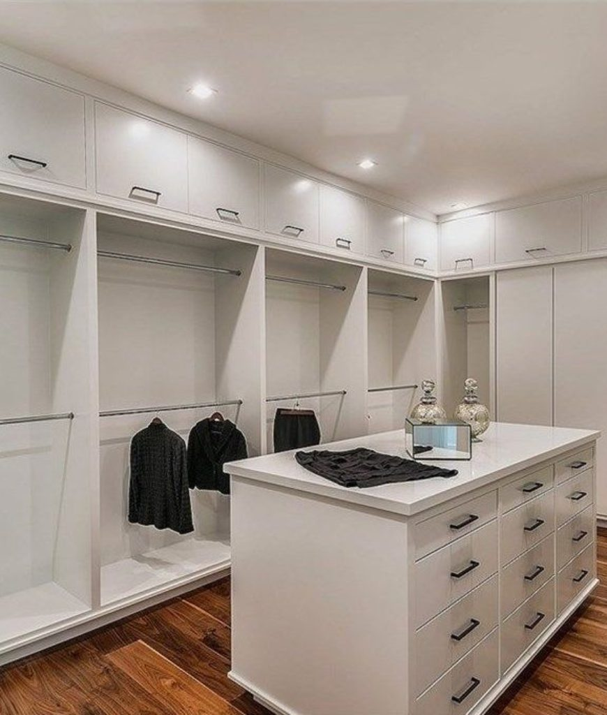 This huge closet is like a dream room for every girls. There are countless of railings of clothes together with an island for accessories and jewelries.