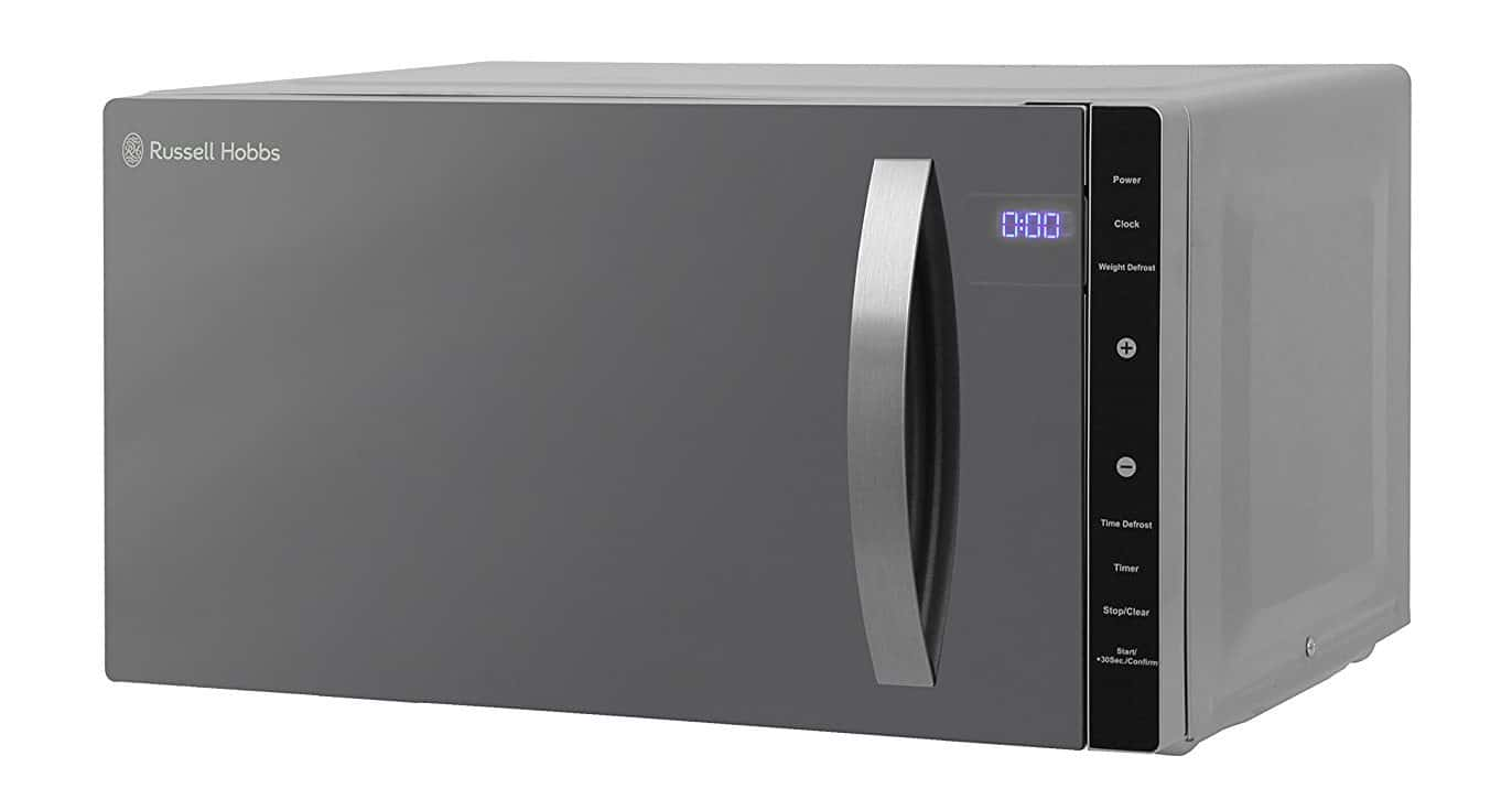 Contemporary silver large flatbed microwave with handy digital clock and count-down timer.