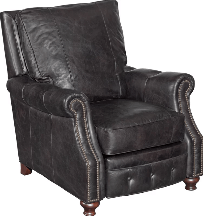 Large manual leather recliner with nailhead trim design and removable cushion seat.
