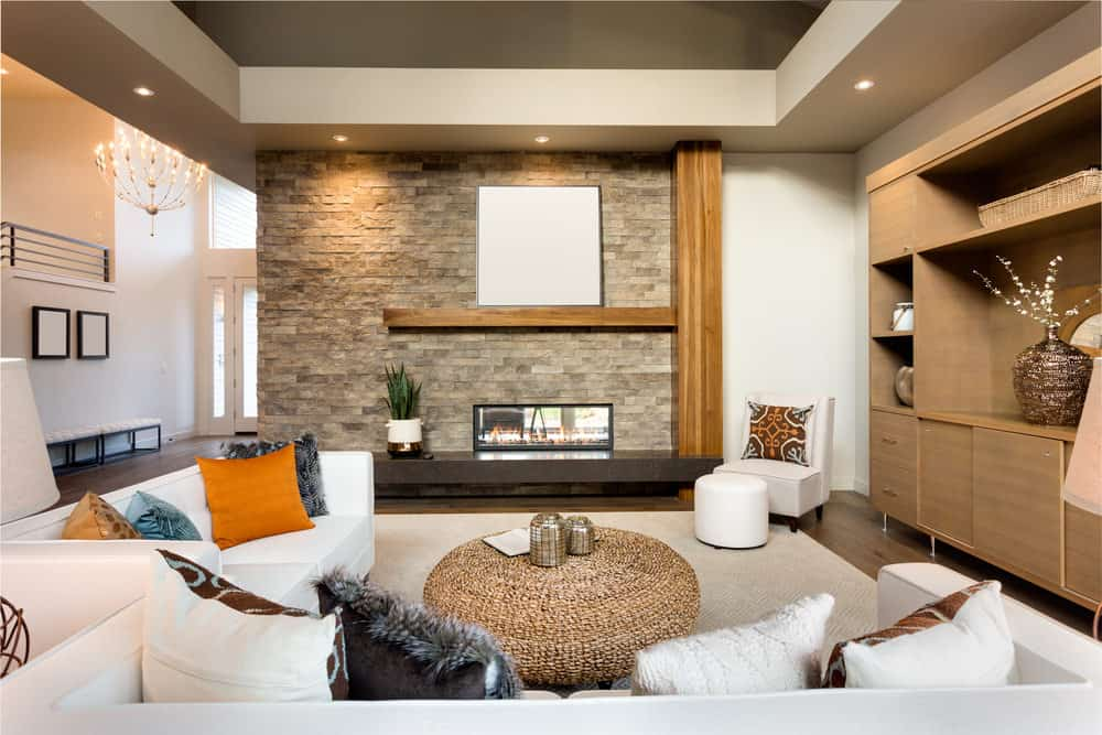 Gorgeous contemporary living room with stone accent wall  650 Formal Living Room Design Ideas for 2018