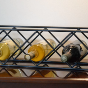 Tabletop wine rack with metal black finish.