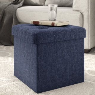 Cube ottoman made with midnight blue color and polyester material.